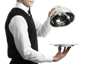 Working as a waiter.